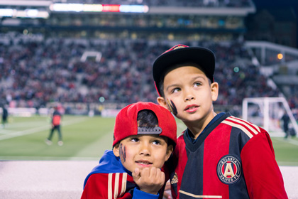 Photo of two children during the Atlanta United game located at Bobby Dodd Stadium in Atlanta, Georgia.