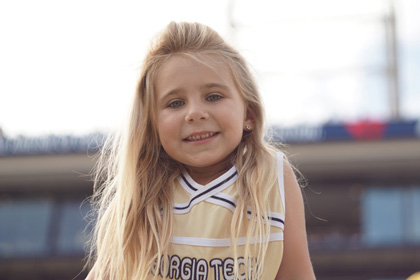 Photo of a girl during a Georgia Tech football game.